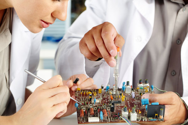 Technicians Fixing Circuit Board