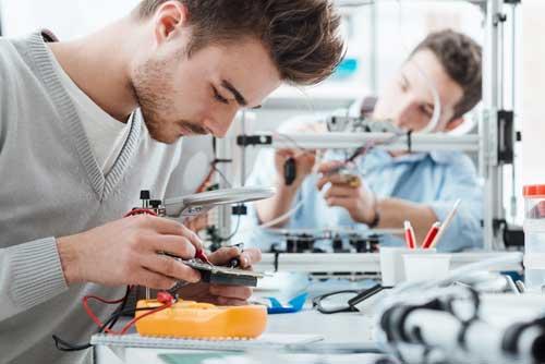Student Repairing PCB