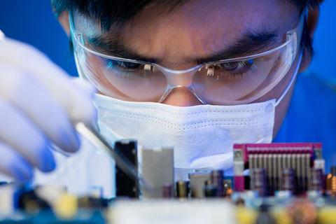 Technician Fixing Circuit Board
